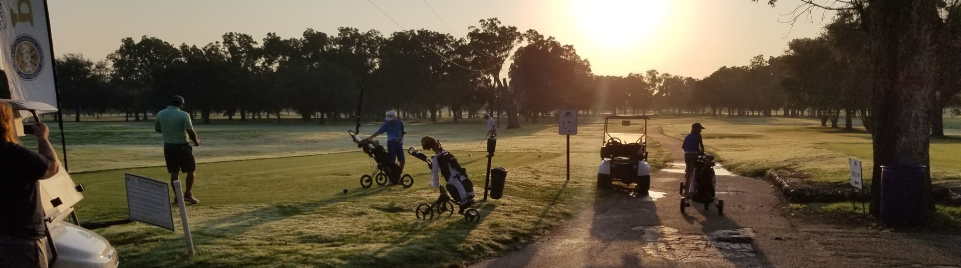 A few golfers golf during dusk at the Riverside Golf Course in Victoria, Texas